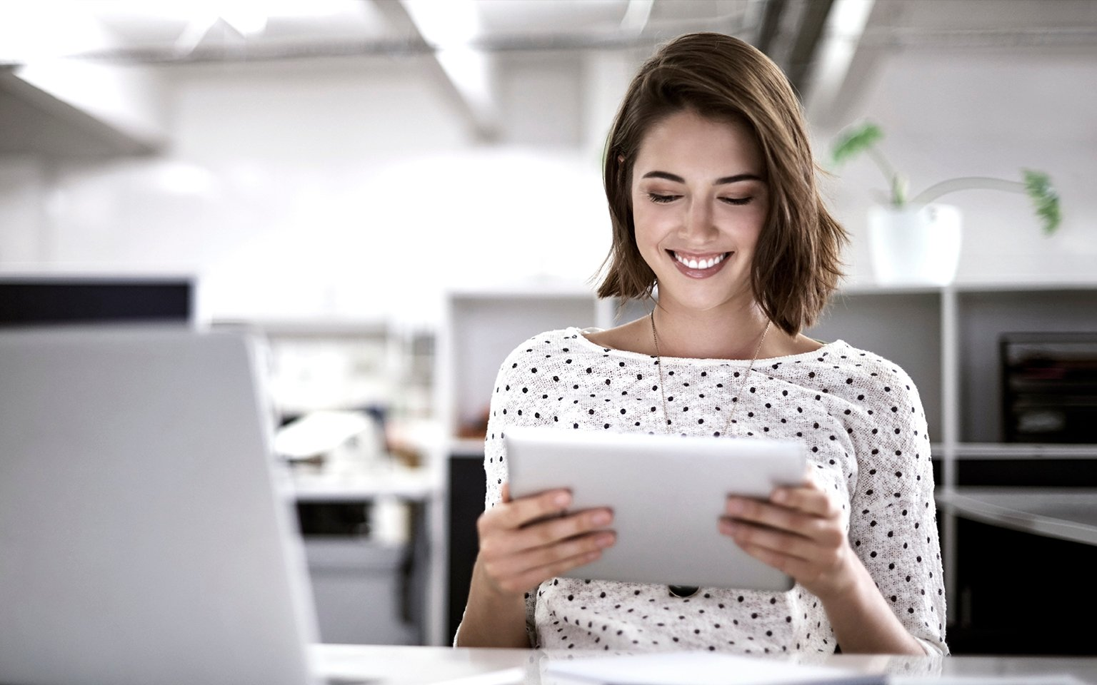 Woman printing from computer tablet