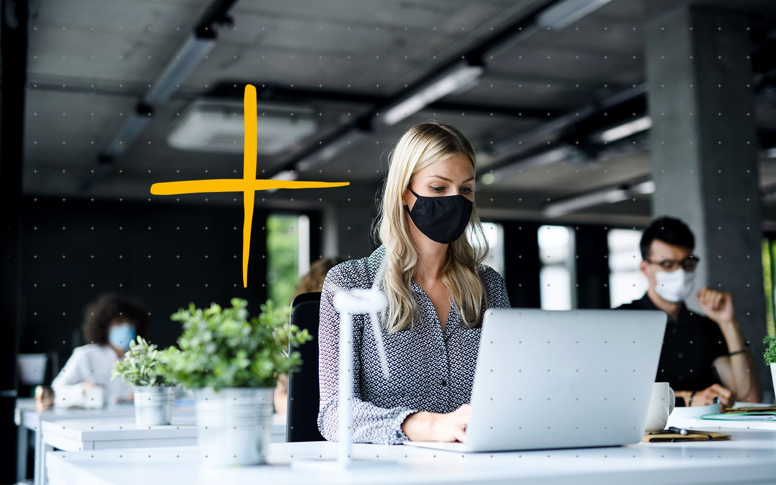 woman wearing mask working at computer